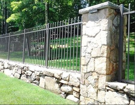 Picture of fencing wall made out of rubble coursed stone wall and columns with iron fencing