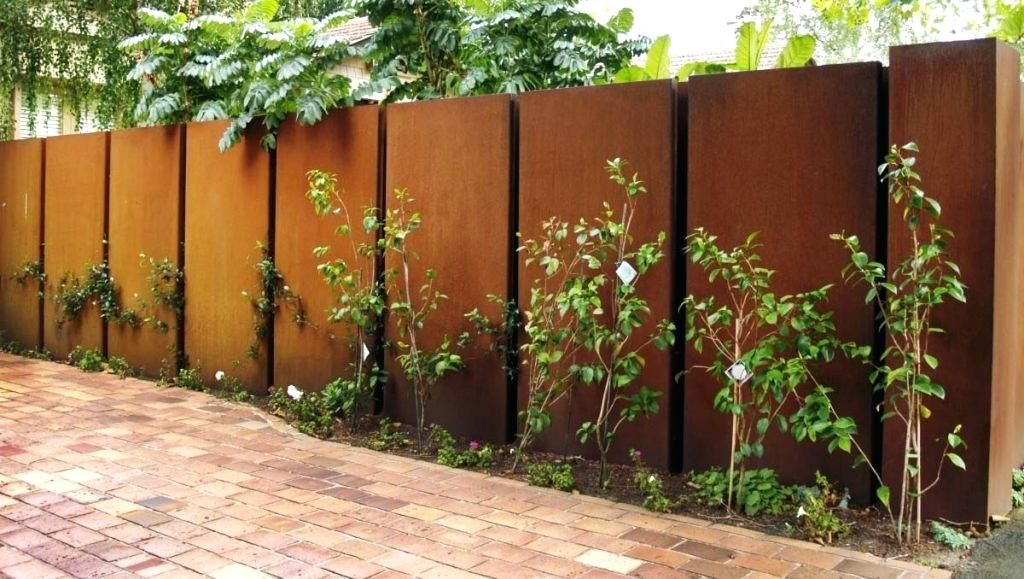Picture of light rusted solid sheet metal fence